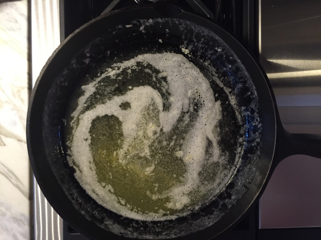 Swirling to coat sides of skillet