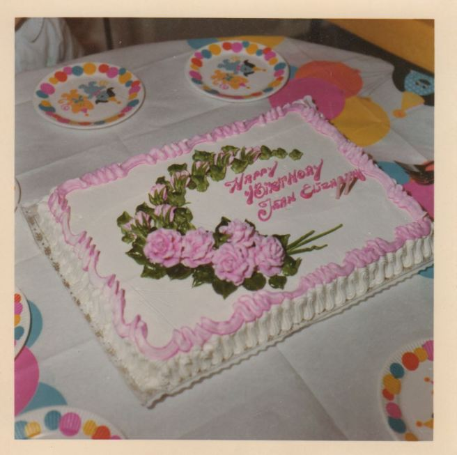 A huge cake for a two year old!  And those flowers!