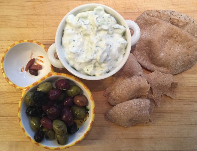 Tzatziki Sauce with olives and pita wedges