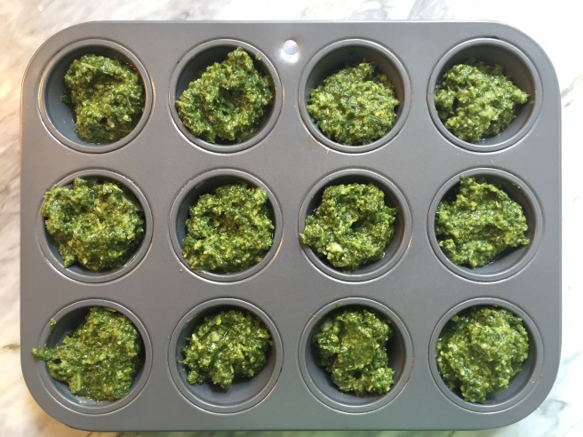 Pesto fills a mini muffin tin