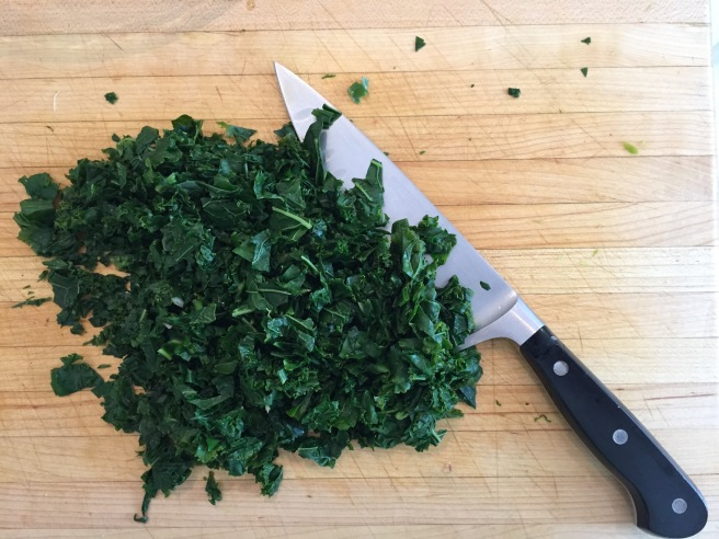 Chopped kale on cutting board.