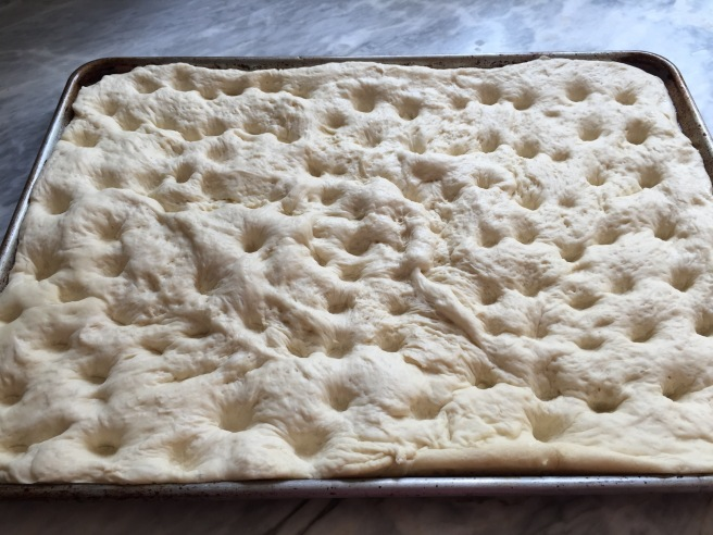 Dimpled focaccia dough