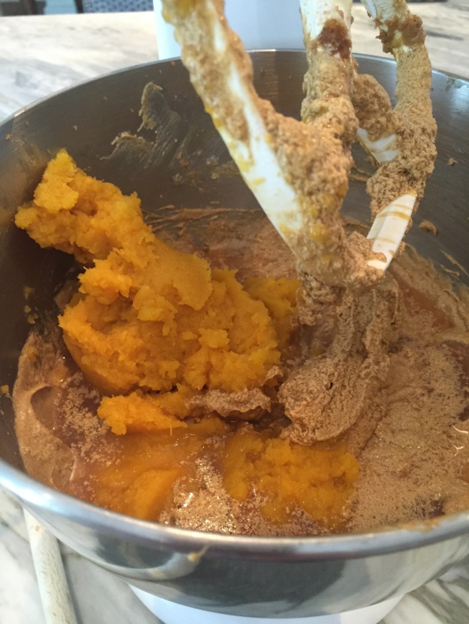 Adding the pumpkin purée and cider to butter, sugar, and egg mixture.