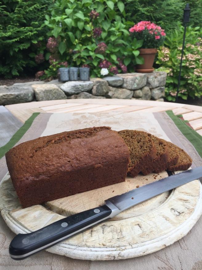 Pumpkin bread sliced on cutting board.