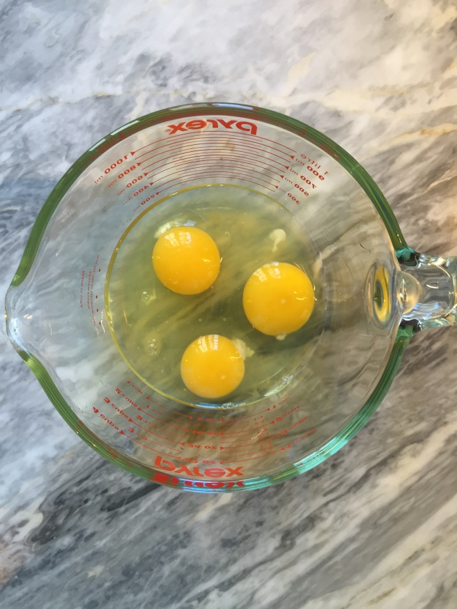 3 eggs ready for whisking.