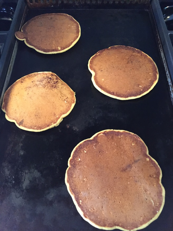 Flipped pancakes on the griddle.