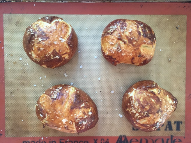 Deep golden brown homemade pretzel buns.