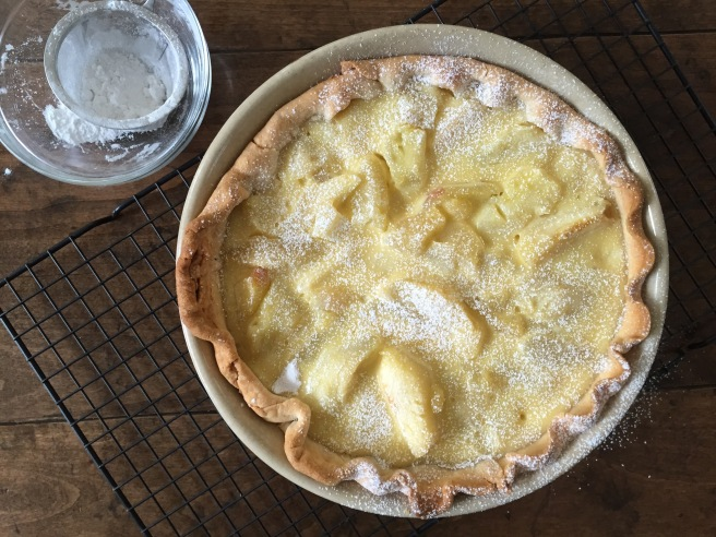 Apple Cream Pie dusted with powdered sugar.