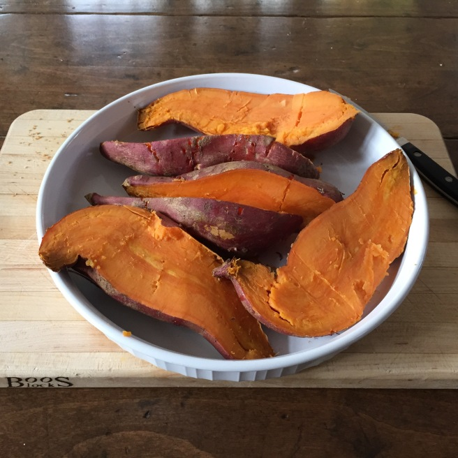 Roasted sweet potatoes cooling.