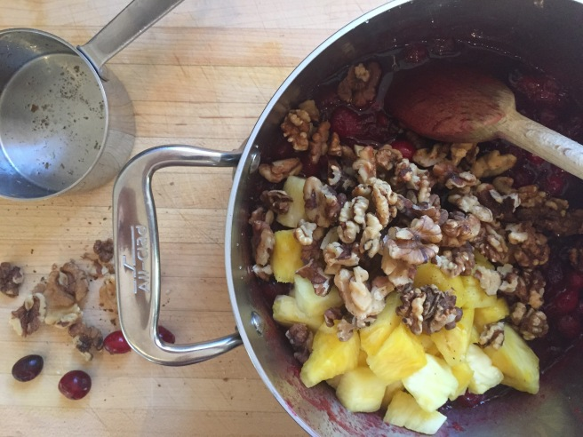 Add chopped walnuts and pineapple to cranberries.