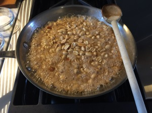 Peanuts in bubbling sugar syrup