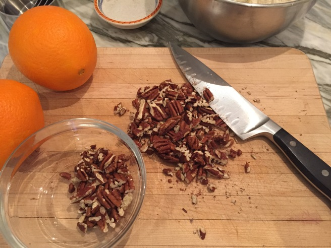 Roughly chopped pecans on a cutting board.