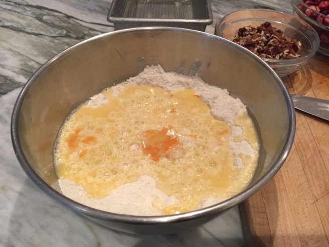 Wet ingredients and dry ingredients in mixing bowl.