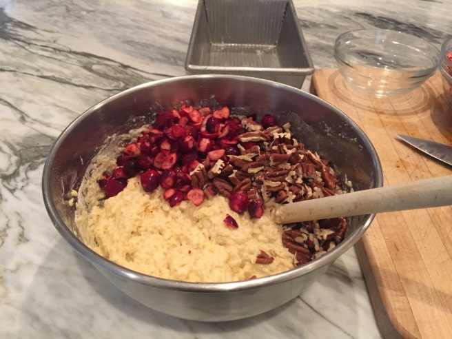 Folding in the cranberries and pecans.