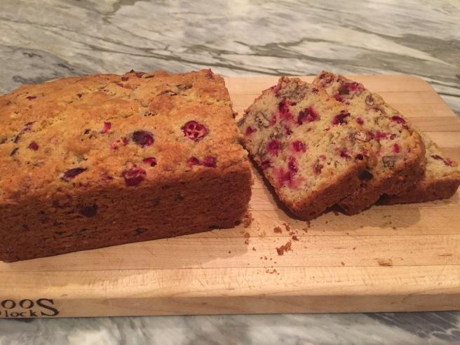 Cranberry Nut Bread- sliced on a cutting board