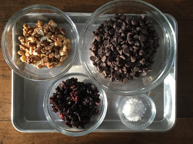 Chocolate Bark ingredients- dark chocolate chips, toasted nuts, dried fruit, and flaked sea salt.