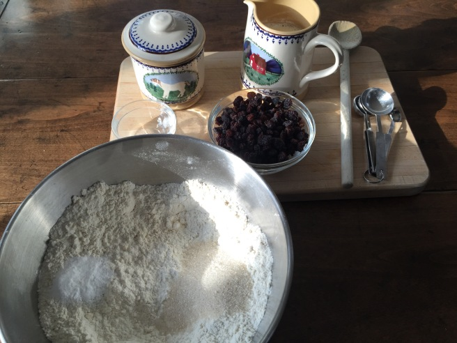 Adding sugar, salt, and baking powder to flour/butter mixture