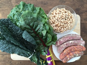 Raw sausage, bunch of kale, bunch of chard, cannellini beans