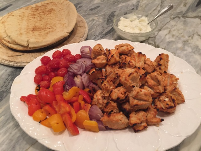 Platter of shish taouk with grilled peppers, onions, and tomatoes
