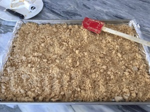 Crumbly flour mixture in foil lined sheet pan