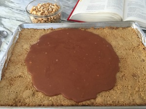 Butterscotch spreading on cookie base.