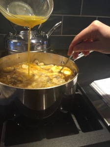 Whisking eggs into soup