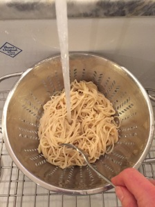 Rinse and drain noodles in colander, separating strands with a fork