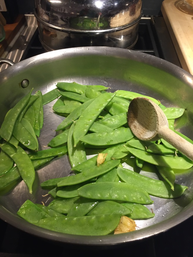 Adding snow peas to skillet