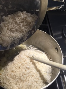 Adding rice to saucepan