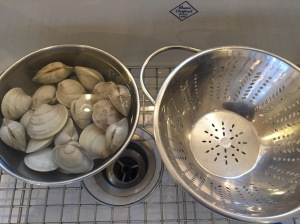 Soaking clams in shells to remove grit