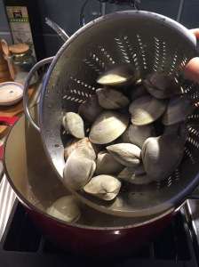 Adding clams to boiling water