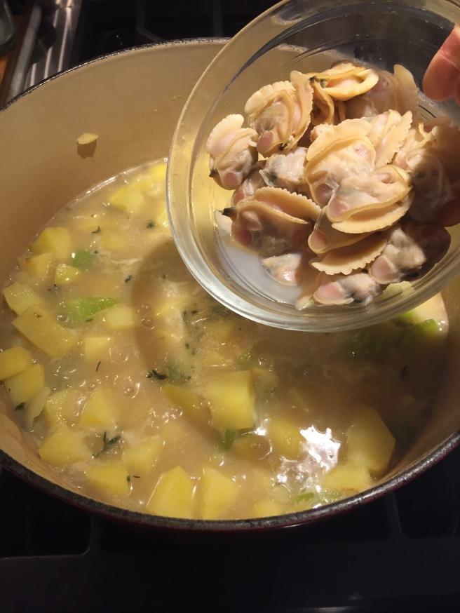Adding clams and any juices that accumulated to dutch oven