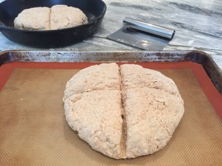 Brown Soda Bread dough cut with deep cross on lined cookie sheet