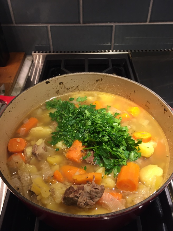 After 1-2 hours, when the meat is tender, add chopped parsley.
