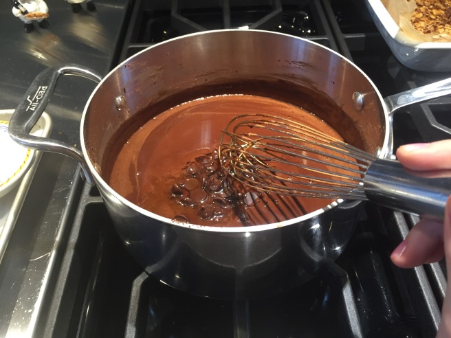 Whisking in chocolate pieces to cocoa mixture