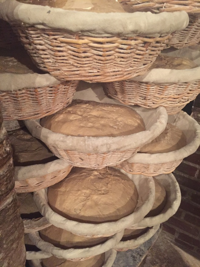 Stacked baskets of rising dough at Poilâne