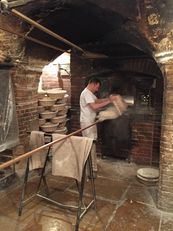 Turning the dough out onto the peel at Poilâne
